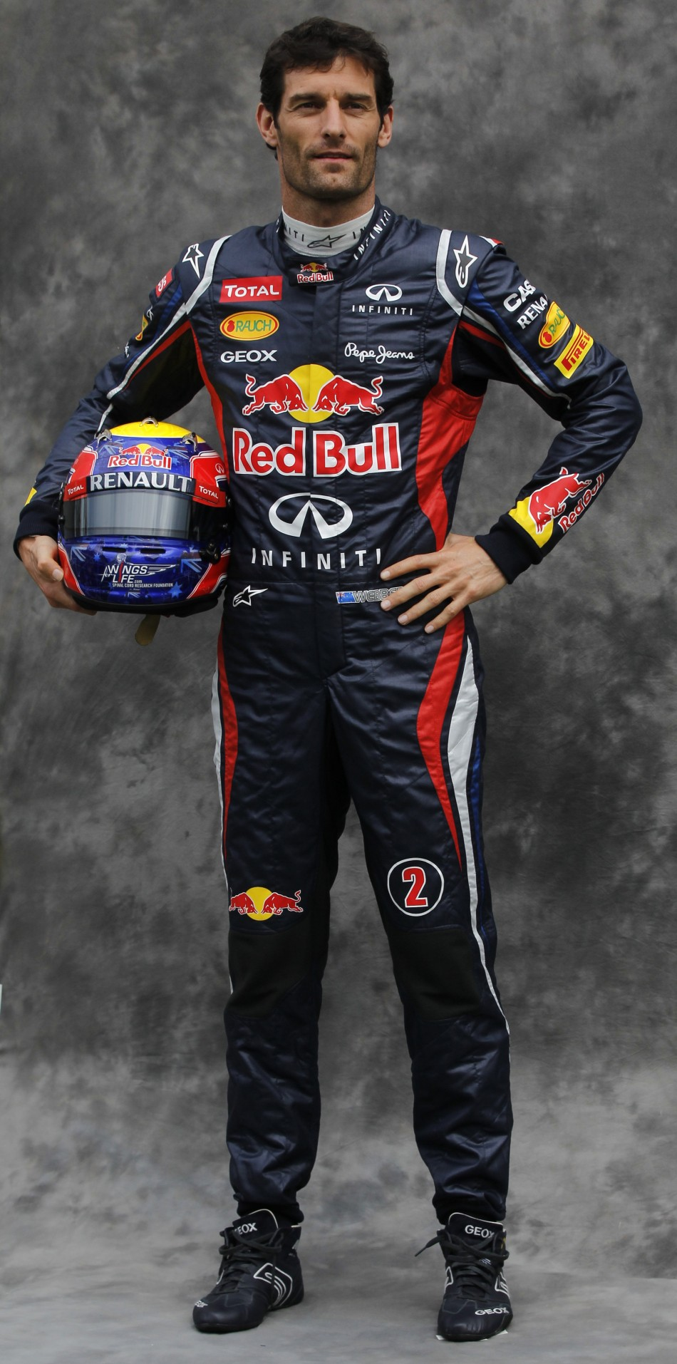 Red Bull Formula One driver Webber poses prior to the Australian F1 Grand Prix at the Albert Park circuit in Melbourne