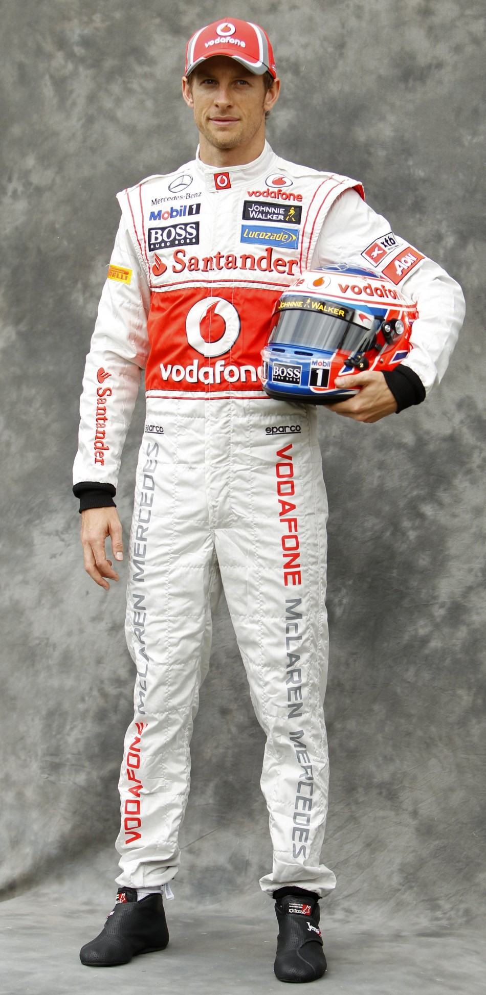 McLaren Formula One driver Button poses prior to the Australian F1 Grand Prix at the Albert Park circuit in Melbourne