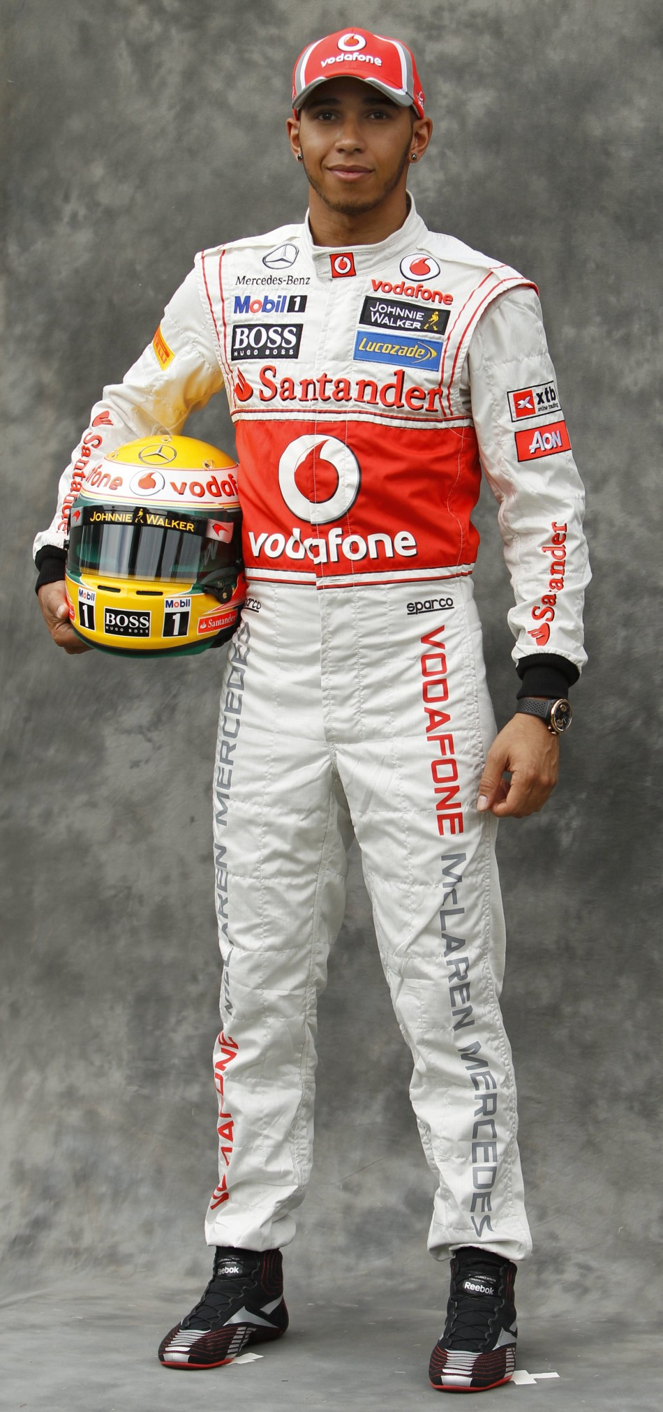 McLaren Formula One driver Hamilton poses prior to the Australian F1 Grand Prix at the Albert Park circuit in Melbourne