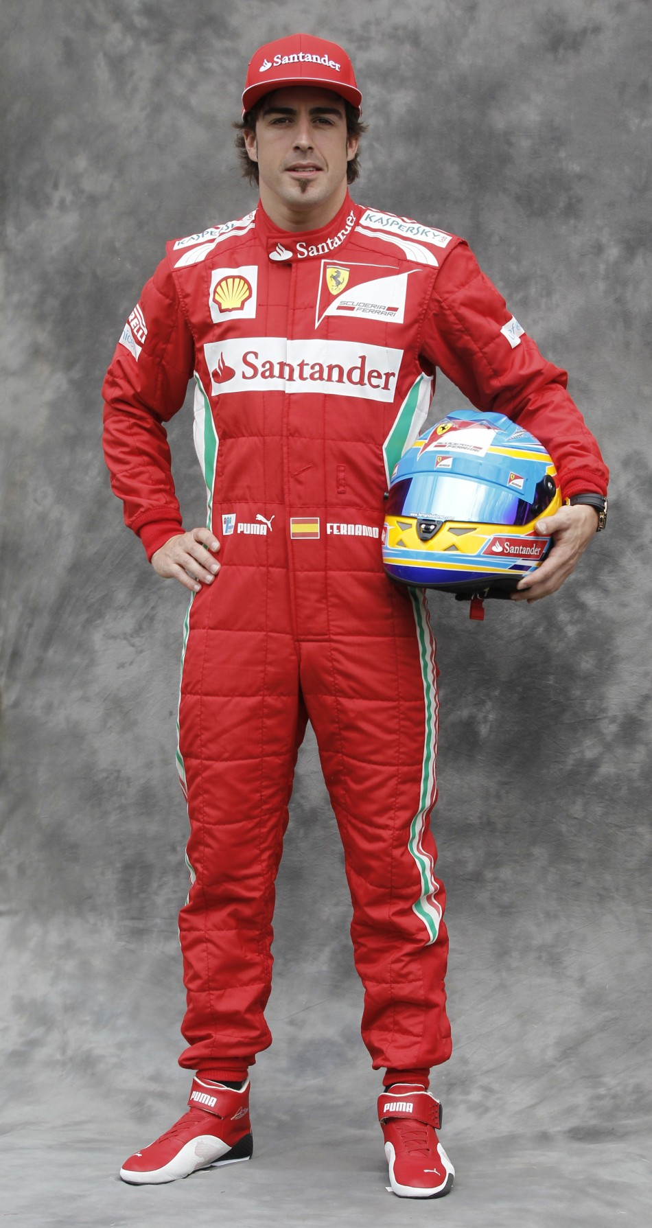 Ferrari Formula One driver Alonso poses prior to the Australian F1 Grand Prix at the Albert Park circuit in Melbourne