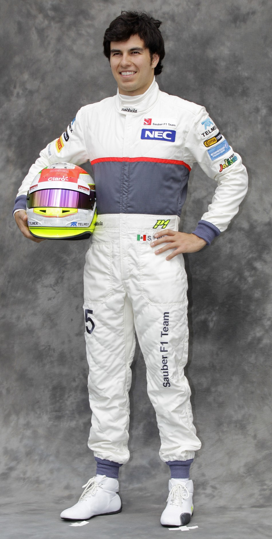Sauber Formula One driver Perez poses prior to the Australian F1 Grand Prix at the Albert Park circuit in Melbourne
