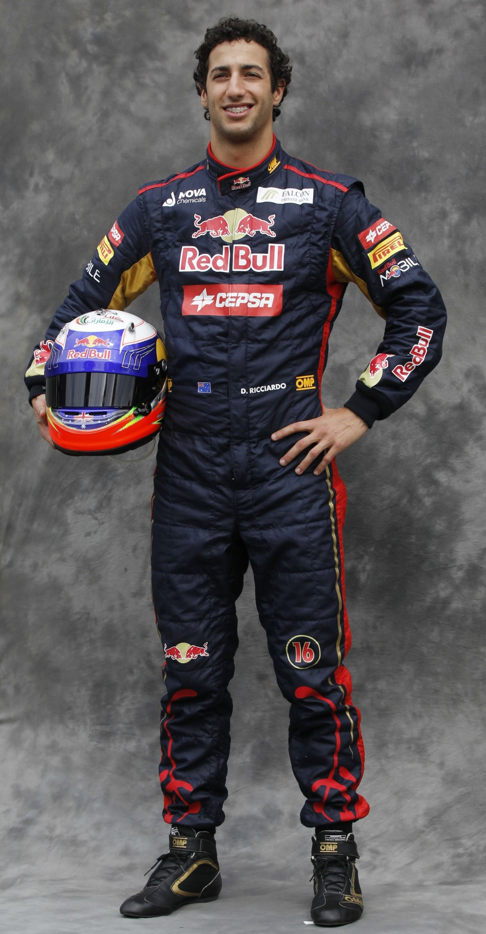 Toro Rosso Formula One driver Ricciardo poses prior to the Australian F1 Grand Prix at the Albert Park circuit in Melbourne