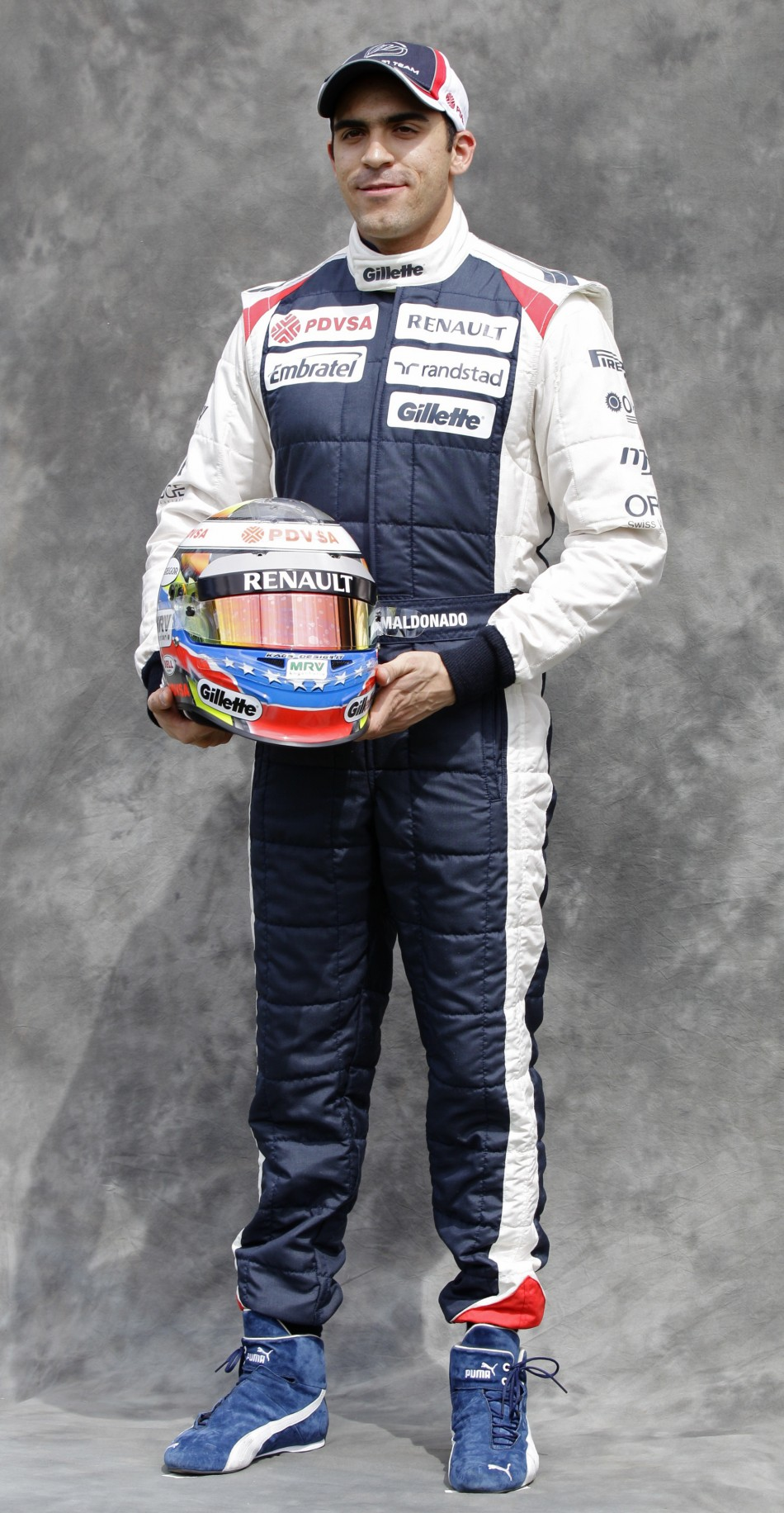Williams Formula One driver Maldonado poses prior to the Australian F1 Grand Prix at the Albert Park circuit in Melbourne