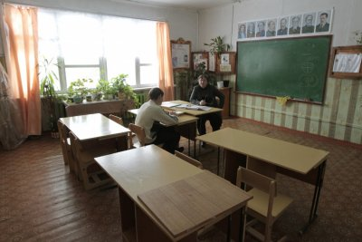 A ninth-grade pupil attends a Russian literature lesson at a school in the remote Russian village of Bolshie Khutora