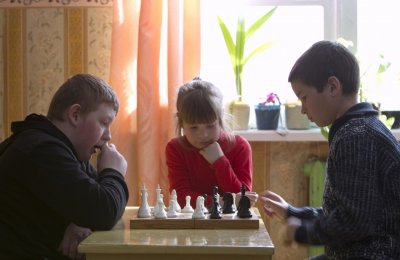 Pupils play chess, as they prepare for the local competitions, at a school based in the remote Russian village of Bolshie Khutora