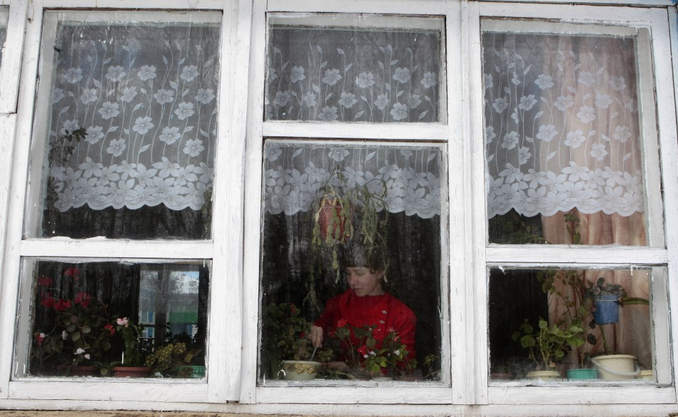 Andronake, a seventh grade pupil, looks after plants at a school based in the remote Russian village of Bolshie Khutora