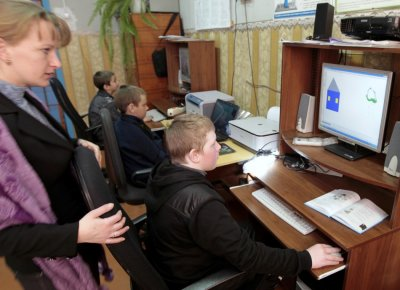 Pupils attend an informatics lesson at a school based in the remote Russian village of Bolshie Khutora