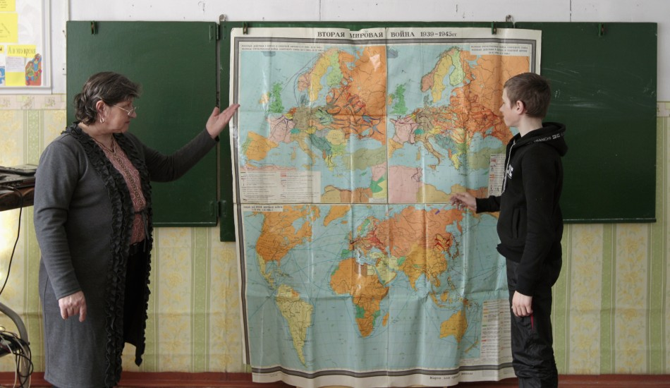 A seventh grade pupil listens to a teacher during a history lesson at a school based in the remote Russian village of Bolshie Khutora
