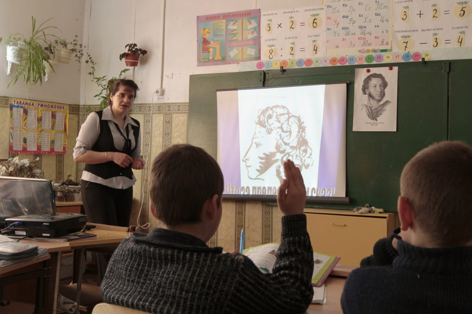Fourth and fifth grade pupils attend a Russian language lesson at a school in the remote Russian village of Bolshie Khutora