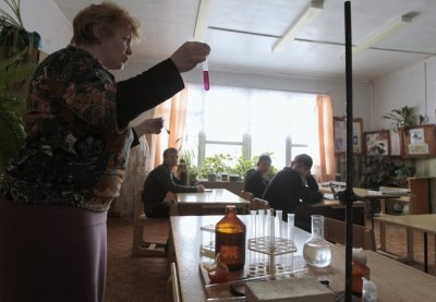 Ninth-grade pupils attend a chemistry lesson at a school based in the remote Russian village of Bolshie Khutora