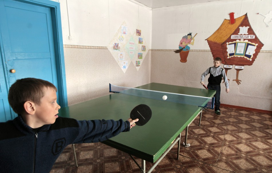 Pupils play table tennis at a local school in the remote Russian village of Bolshie Khutora