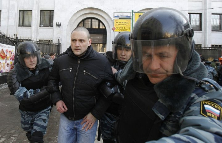 Riot police detain Left Front movement leader Sergei Udaltsov during demonstration for fair elections in central Moscow