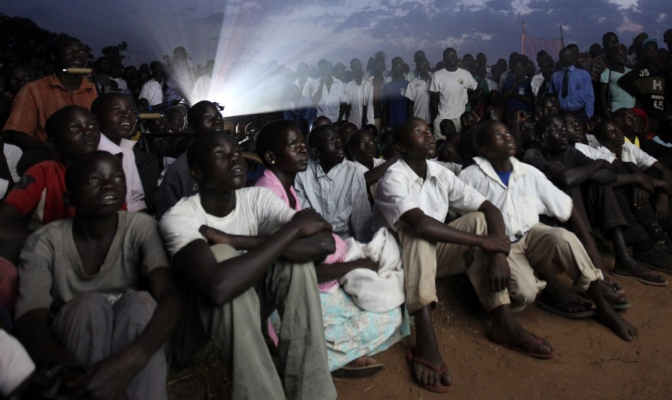 Residents watch the premiere of