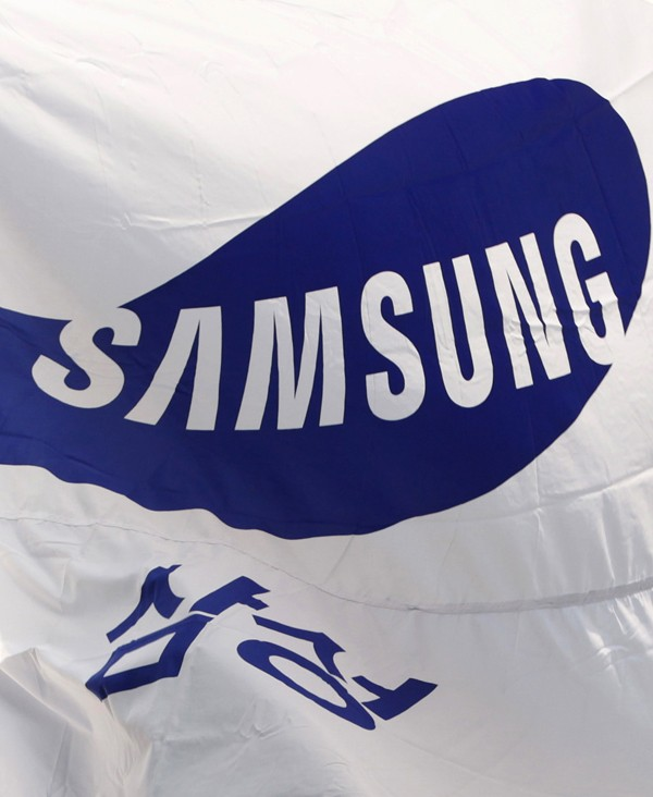 Flag of Samsung flutters in the wind at the company's main office building in Seoul