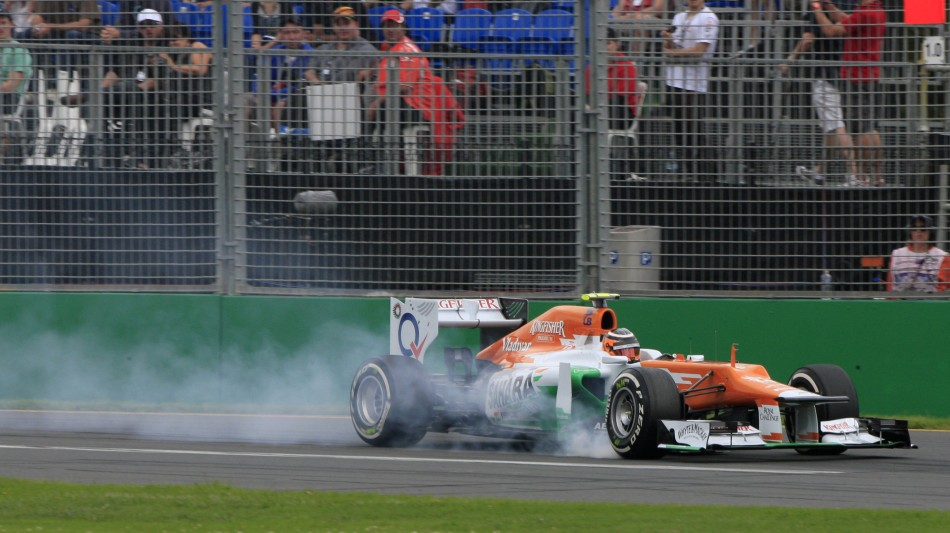 Force India Formula One driver Hulkenberg locks his brakes during the first practice session of the Australian F1 Grand Prix at the Albert Park circuit in Melbourne