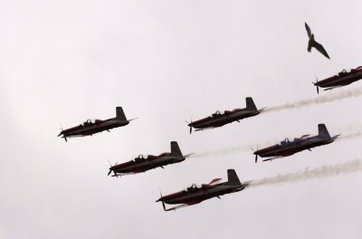 The Royal Australian Air Force aerobatic team, The Roulettes, perform over the Albert Park circuit before the first practice session of the Australian F1 Grand Prix in Melbourne