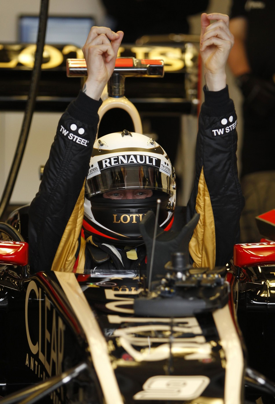 Lotus F1 Formula One driver Raikkonen gets into his car during the first practice session of the Australian F1 Grand Prix at the Albert Park circuit in Melbourne