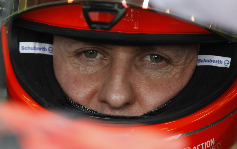 Mercedes Formula One driver Schumacher sits in his car during the second practice session of the Australian F1 Grand Prix at the Albert Park circuit in Melbourne