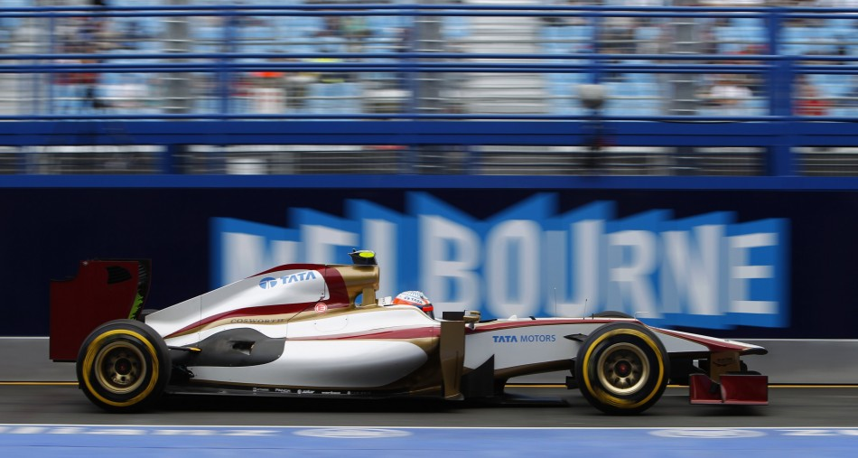 HRT Formula One driver Karthikeyan drives in the pit lane during the second practice session of the Australian F1 Grand Prix at the Albert Park circuit in Melbourne