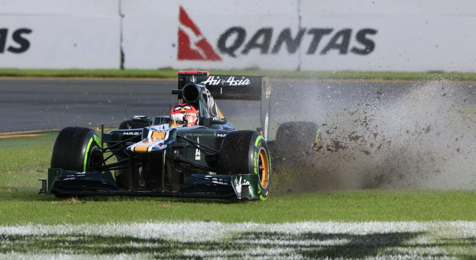 Caterham Formula One driver Kovalainen drives on the grass during the second practice session of the Australian F1 Grand Prix at the Albert Park circuit in Melbourne