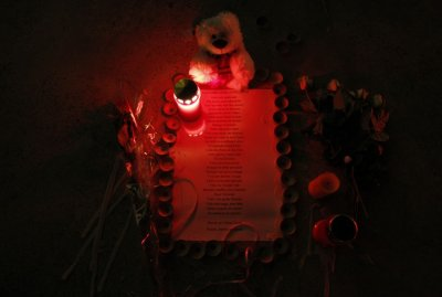 A lit candle and a teddy bear are seen next to the lyrics of singer Celine Dions song quotVolequot to pay tribute to the victims of Sierres bus crash at the Lac de Geronde outside Sierre A lit candle and a teddy bear are seen next to the lyrics of