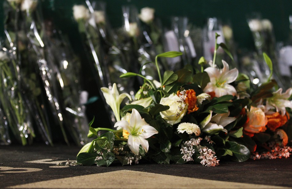 Flowers are placed at scene of an accident inside Tunnel de Sierre, during a news conference in Sierre