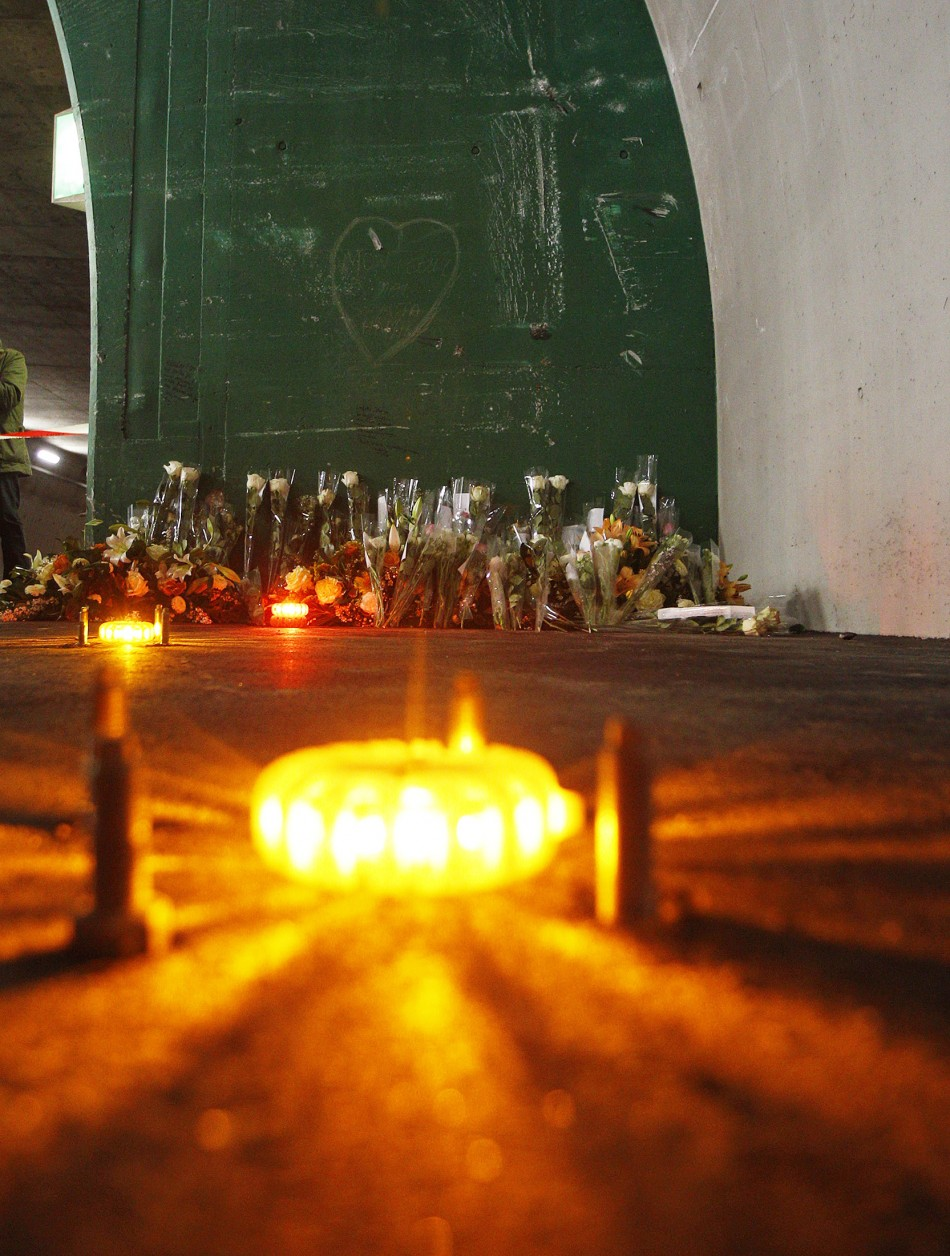 Candles and flowers are seen at the scene of an accident inside the Tunnel de Sierre during a news conference in Sierre