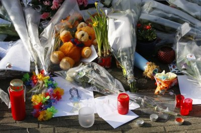 Flowers and other tributes are seen in front of the t Stekske school in Lommel