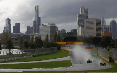 Toro Rossos Vergne and Ricciardo drive during the second practice session of the Australian F1 Grand Prix at the Albert Park circuit in Melbourne