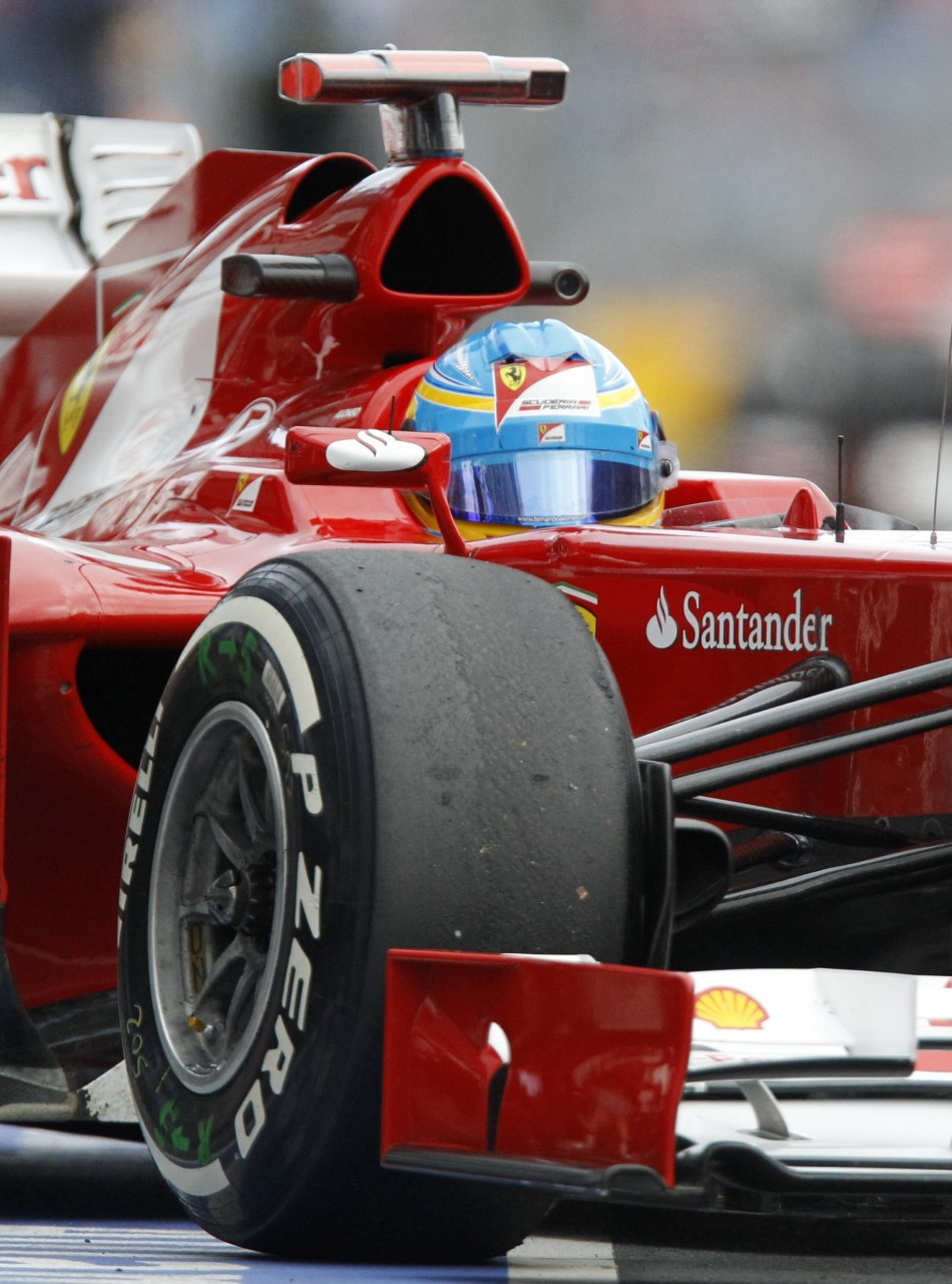 Ferrari Formula One driver Alonso drives during the second practice session of the Australian F1 Grand Prix at the Albert Park circuit in Melbourne