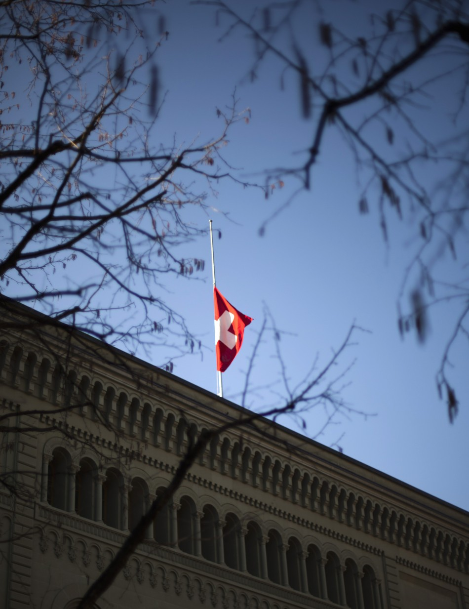 A Swiss flag flies at half-mast outside the building of the Swiss Foreign Department in Bern