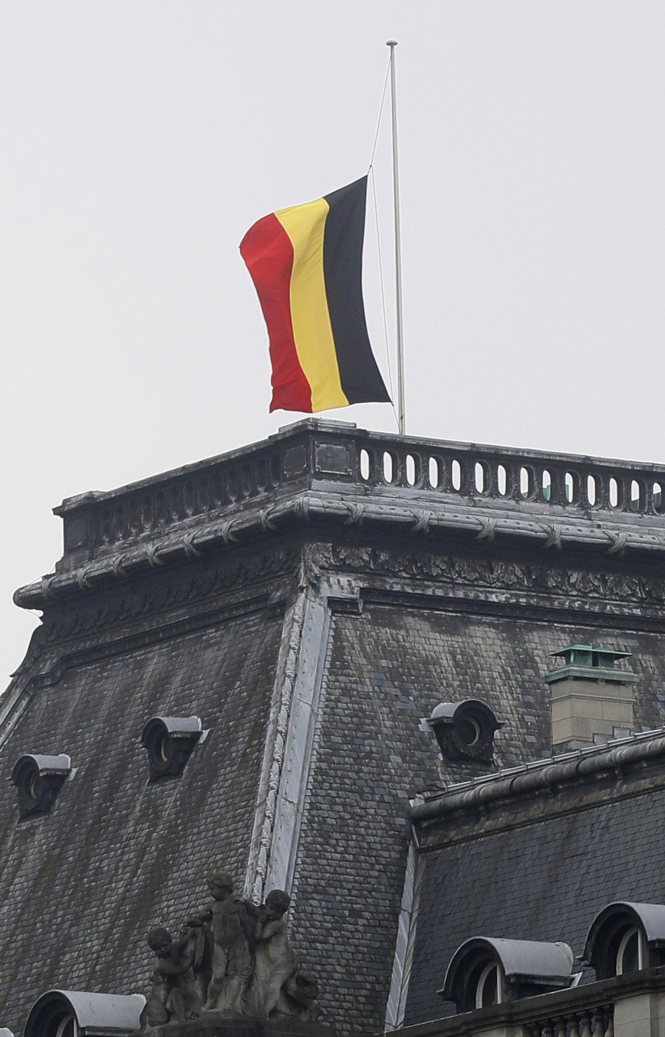 A Belgian flag flies at half mast outside the Belgian Royal Palace in Brussels
