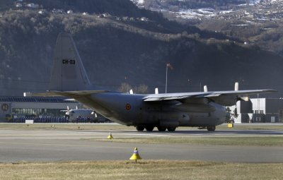 A Belgian army Hercules aircraft carrying an unknown number of bodies gets ready to take off at the airport in Sion