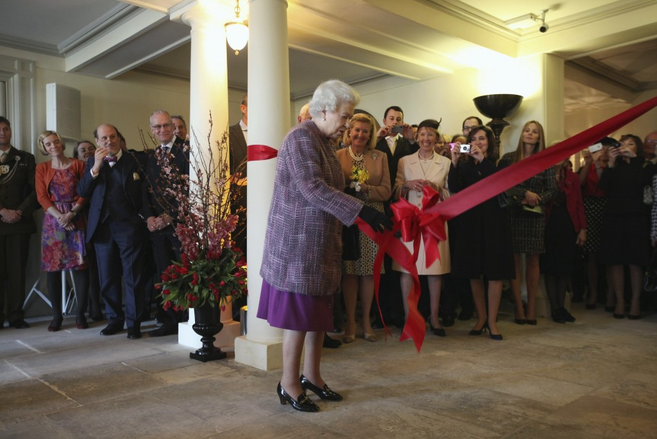 Britain039s Queen Elizabeth pulls the ribbon during the official reopening of Kensington Palace in London
