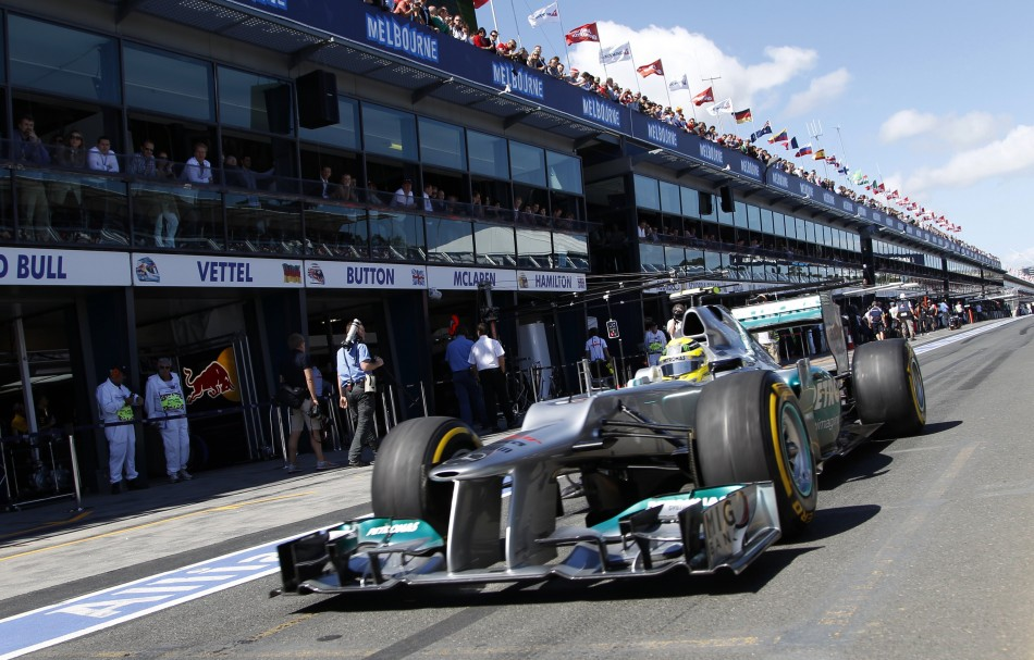 Mercedes Formula One driver Rosberg drives in the pit lane during the third practice session of the Australian F1 Grand Prix at the Albert Park circuit in Melbourne
