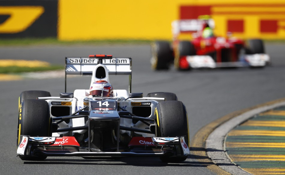 Sauber's Kobayashi drives ahead of Ferrari's Massa during the third practice session of the Australian F1 Grand Prix at the Albert Park circuit in Melbourne