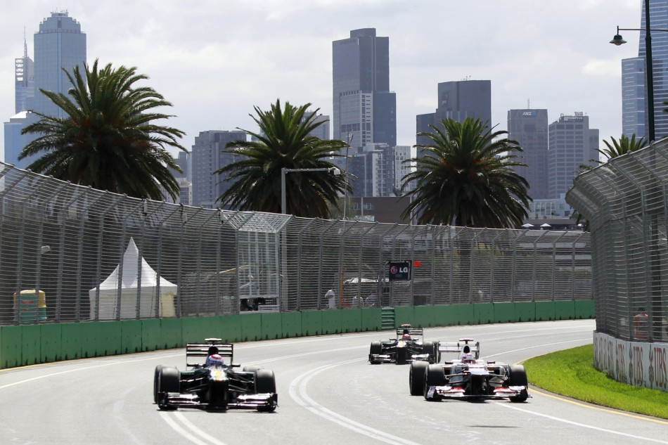 Caterham's Petrov and Kovalainen and Sauber's Kobayashi drive during the third practice session of the Australian F1 Grand Prix at the Albert Park circuit in Melbourne