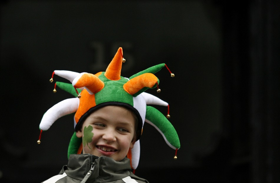 A boy wearing a hat in Irish national colours smiles during the Saint Patrick's Day parade along Dublin's city centre