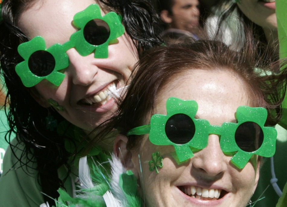 Irish women wear clover-shaped sunglasses as they watch a parade in Tokyo