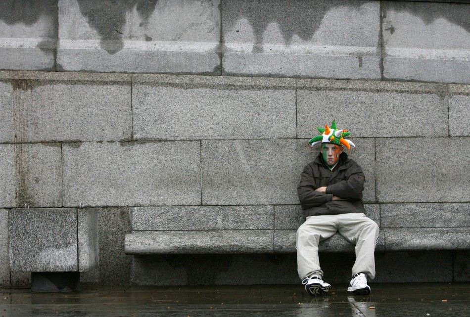 A man sits down during St Patrick's day celebrations in Trafalgar Square in central Londo