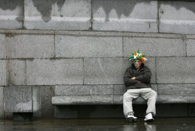 A man sits down during St Patricks day celebrations in Trafalgar Square in central Londo