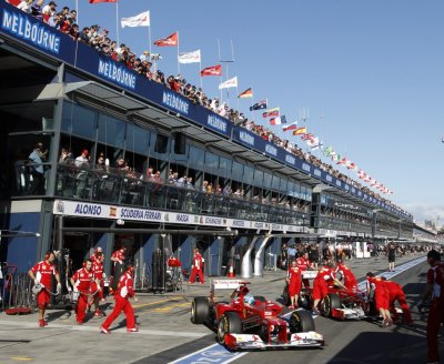 Ferrari Formula One drivers Alonso and Massa are pushed back to their garages during the qualifying session of the Australian F1 Grand Prix at the Albert Park circuit in Melbourne