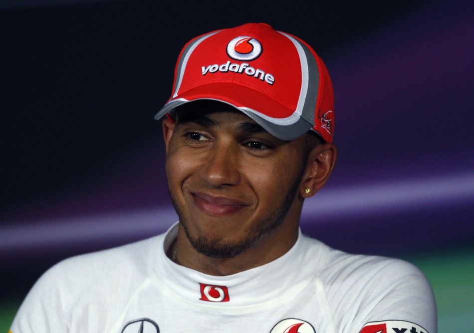 McLaren Formula One driver Hamilton smiles during the post-qualifying news conference of the Australian F1 Grand Prix at the Albert Park circuit in Melbourne