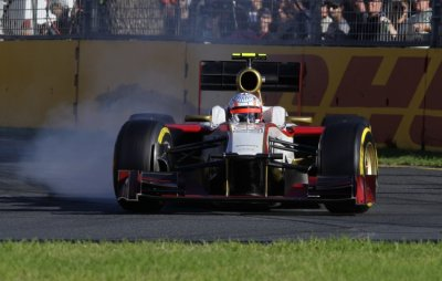 HRT Formula One driver Karthikeyan drives during the qualifying session of the Australian F1 Grand Prix at the Albert Park circuit in Melbourne