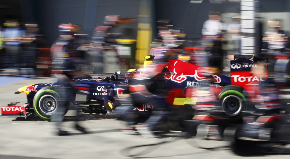 Red Bull Formula One driver Mark Webber of Australia drives out from his pit during the qualifying session of the Australian F1 Grand Prix at the Albert Park circuit in Melbourne
