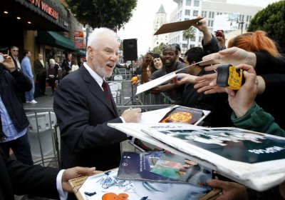 McDowell signs autographs after his star was unveiled on the Walk of Fame in Hollywood