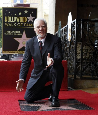 McDowell poses on his star after it was unveiled on the Walk of Fame in Hollywood