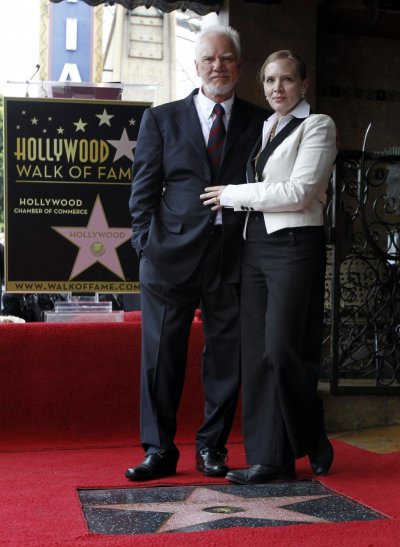 British actor Malcolm McDowell and his wife Kelley McDowell pose by his star after it was unveiled on the Walk of Fame
