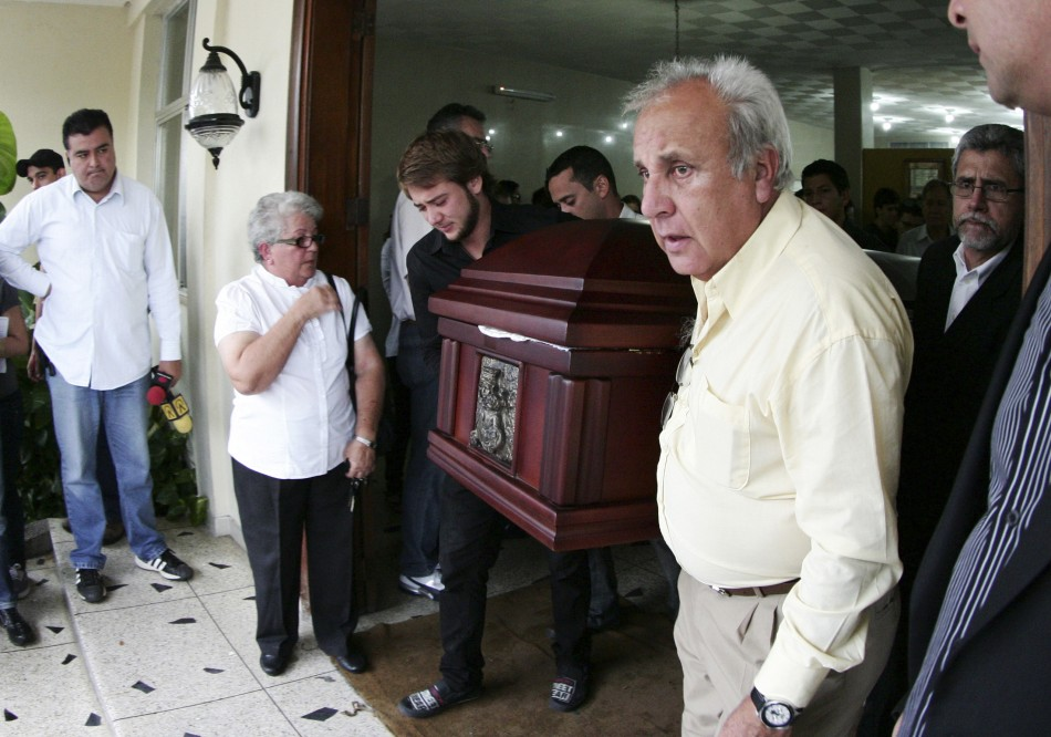 Fernando Berendique, Head of Mission at the Chilean Consulate in Maracaibo, carries the coffin of his 19-year-old daughter Karen, in Maracaibo