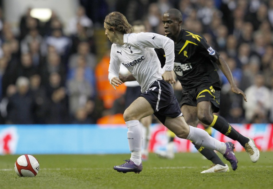 Tottenham Hotspur039s Modric runs with the ball next to Bolton Wanderers039 Muamba during their English FA Cup quarter-final soccer match in London